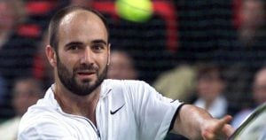 Andre Agassi - Swinging his tennis racket in a match.