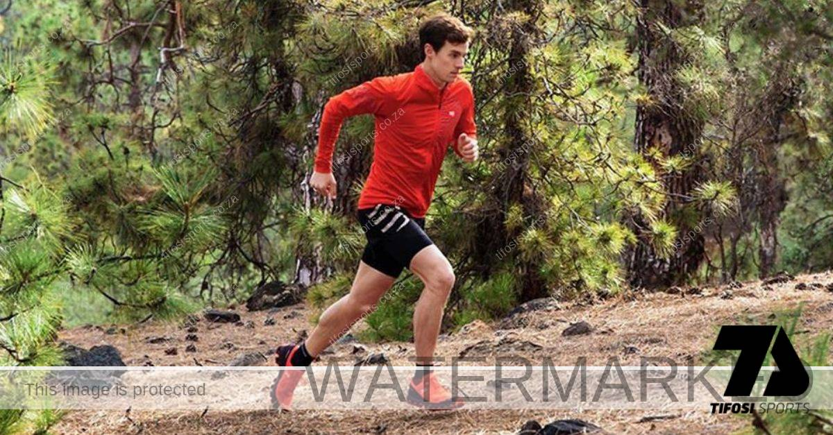 Athlete running on a trail with On CloudVenture - Tifosi Sports